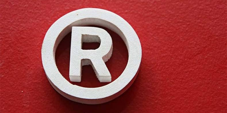 White registered trademark symbol on red background