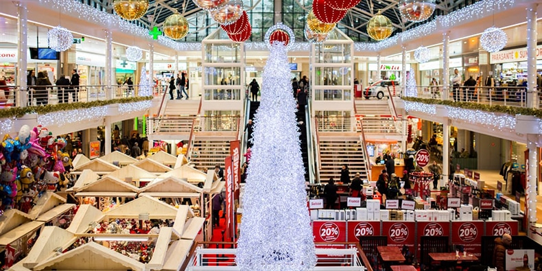 Busy shopping mall decorated for Christmas