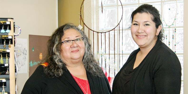 Yvonne Jobin and Amy Willier, Owners of Moonstone Creation, in their shop