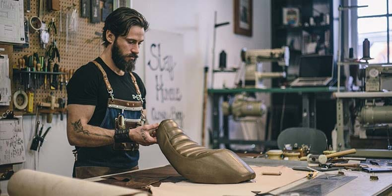 Kyle Closen working with leather in his shop