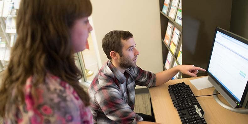 Colleagues working together at computer