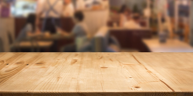 wood table counter with blurred food center for display food