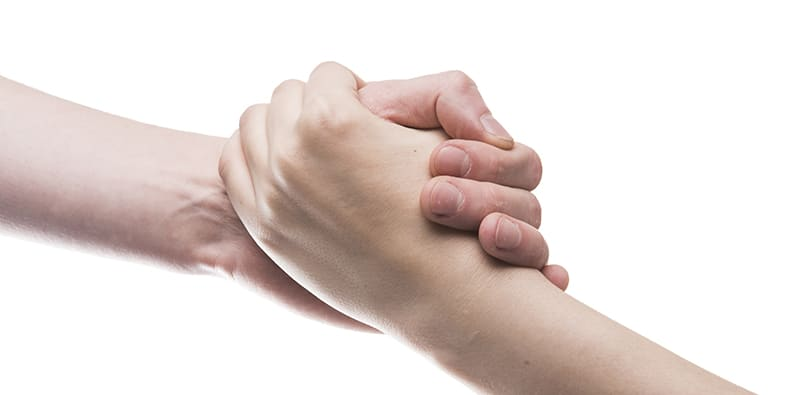 Two people holding hands; trusted advisor