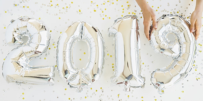 Silver number balloons spelling out 2019